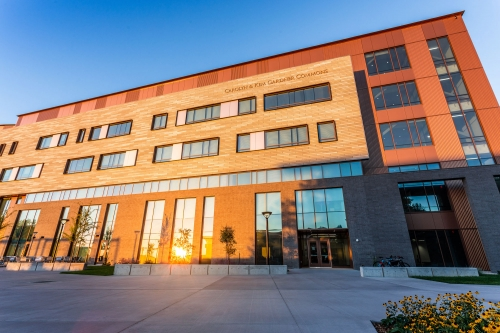The west entrance of the Carolyn and Kem Gardner Commons at sunset.